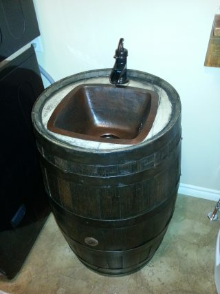 Custom sink fitted to a whiskey barrel.