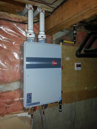 Residential tankless hot water heater installation.